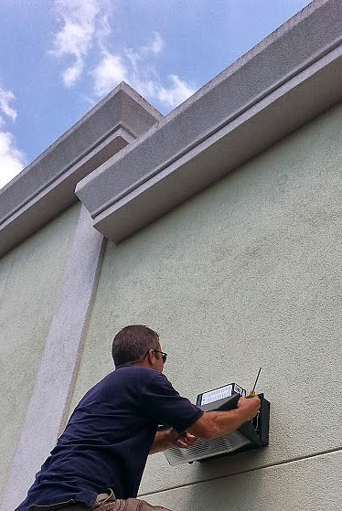 MPS tech replacing exterior lighting. No job is too small or too high.