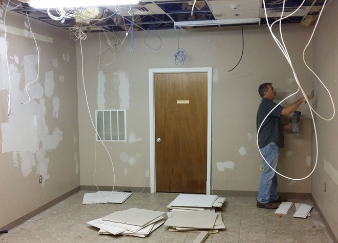 Repair and renovation of media room Mainstreet Property Services.